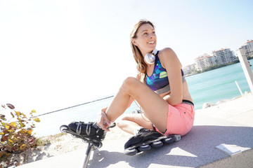 Roller skater relaxing and listening To music with headphones