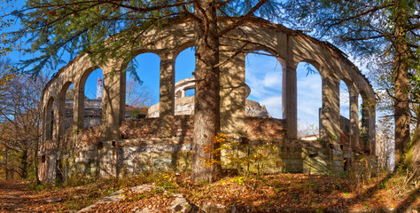 The arcade of the abandoned building of the former restaurant on the top of Mount Akhun in sunny autumn day, Sochi, Russia