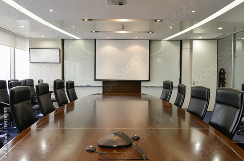 Business Board Room With White Projector Screen And Ip Phone Stock