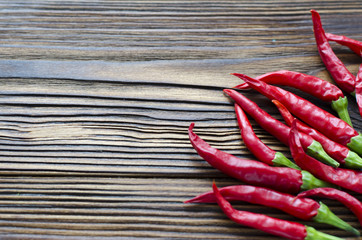 group of chili peppers on brown wooden background
