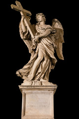 Statue of an angel holding a cross at Ponte Sant'Angelo, Rome. Isolated on black. Clipping path available