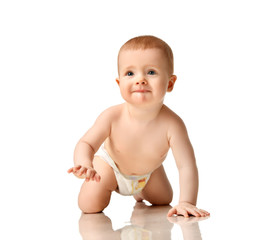 Infant child boy toddler in diaper crawl happy smiling