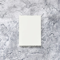 photo frame or board hanging on a decorated gray wall with cracks close-up