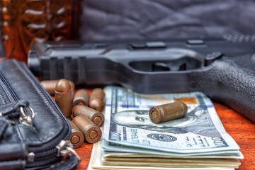 Bullets, money, weapons demonstrating the concept of a bandit. Terrorist activity.