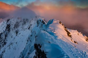 Beautiful sunset on mountain ridge, winter Tatra mountains, Poland