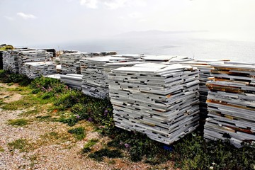 Big piles of marble stone tiles in Tinos island, Greece.