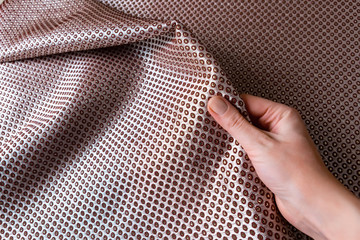 texture of the fabric, side, background of fabric in the highlight. lilac color
