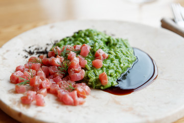 Green spinach risotto with marinated tuna fillet