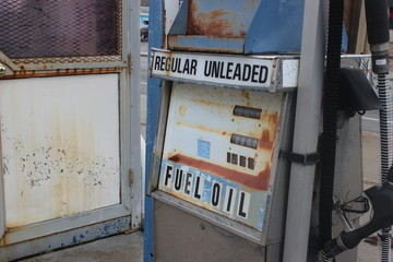 Old sign at abandoned gas station
