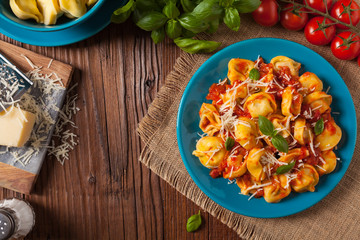 Delicious tortellini with meat in tomato sauce.