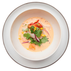 Sea bass ceviche shot from above, isolated on white