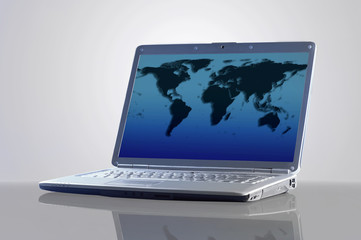 Laptop with a map of the world