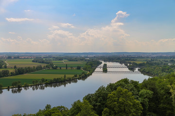 Panoramic view over a wide river in summer