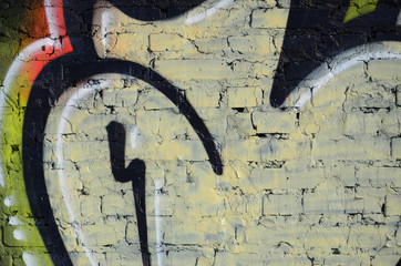 The old wall, painted in color graffiti drawing red aerosol paints. Background image on the theme of drawing graffiti and street art