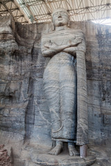 Standing Buddha statue at Gal Vihara rock temple in the ancient city Polonnaruwa, Sri Lanka