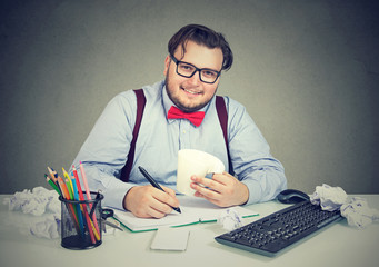 Content chunky man at workplace