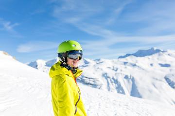 Photo of sports man wearing helmet on snowy slope