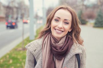 Charming young girl smiling at camera