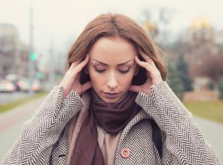 portrait stressed sad woman outdoors. City urban life style stress