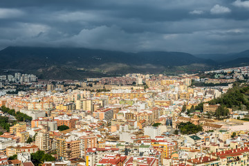 Cityscape aerial view of Malaga before the rain, Andalusia, Spain