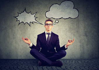 business man is meditating to relieve stress of busy corporate life