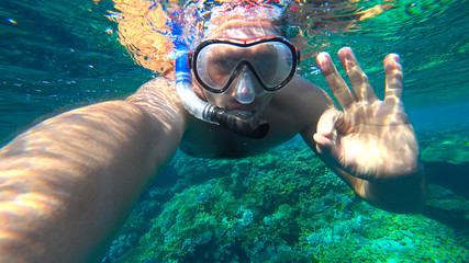 snorkler shows a gesture that is all right