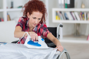 woman ironing a top