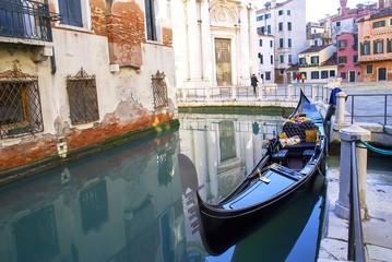 Gondola on venetian canal