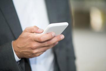 Businessman using his phone