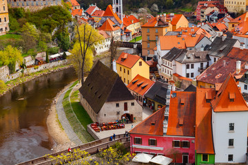 Aerial view of the mill and old town of Cesky Krumlov along the river, Czech republic. Bright spring time.