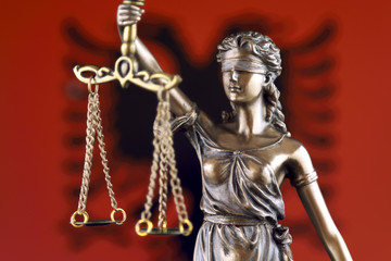 Symbol of law and justice with Albania Flag. Close up.