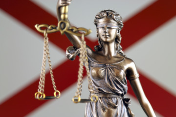 Symbol of law and justice with Alabama State Flag. Close up.