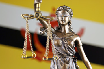 Symbol of law and justice with Brunei Flag. Close up.
