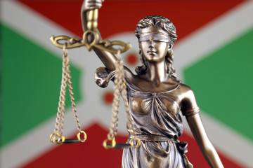 Symbol of law and justice with Burundi Flag. Close up.
