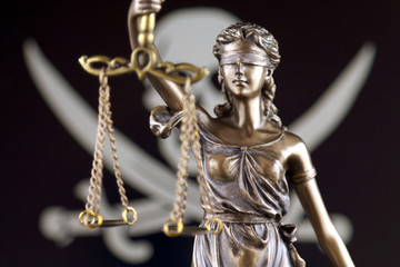 Symbol of law and justice with Pirate Flag.