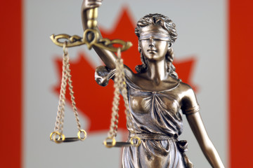 Symbol of law and justice with Canada Flag. Close up.