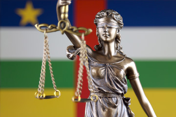 Symbol of law and justice with Central African Republic Flag. Close up.
