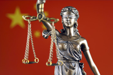 Symbol of law and justice with China Flag. Close up.