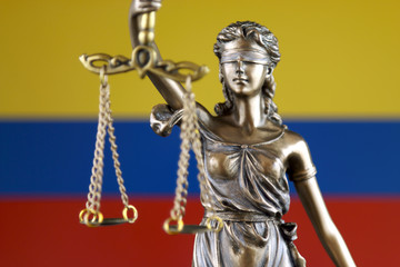 Symbol of law and justice with Colombia Flag. Close up.