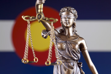 Symbol of law and justice with Colorado State Flag. Close up.