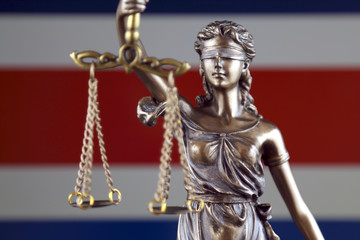 Symbol of law and justice with Costa Rica Flag. Close up.