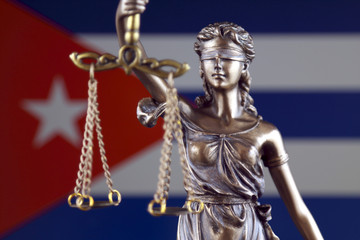 Symbol of law and justice with Cuba Flag. Close up.