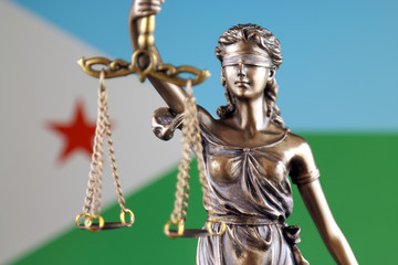 Symbol of law and justice with Djibouti Flag. Close up.