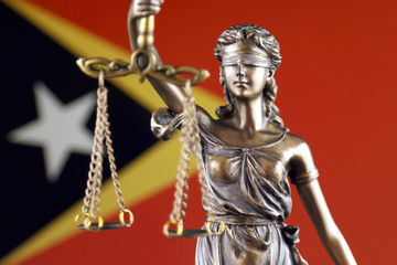 Symbol of law and justice with East Timor Flag. Close up.