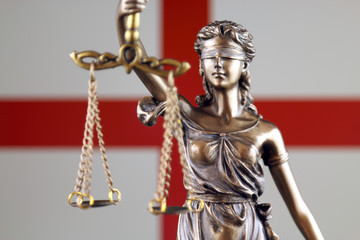 Symbol of law and justice with England Flag. Close up.