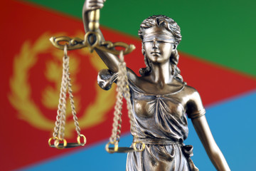 Symbol of law and justice with Eritrea Flag. Close up.