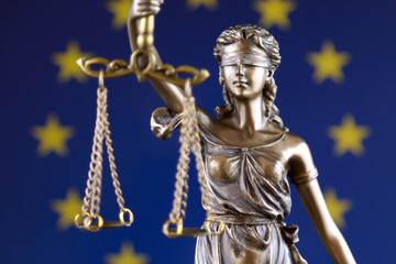 Symbol of law and justice with European Union Flag. Close up.