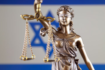 Symbol of law and justice with Israel Flag. Close up.