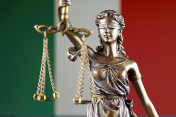 Symbol of law and justice with Italy Flag. Close up.