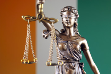 Symbol of law and justice with Ivory Coast Flag. Close up.
